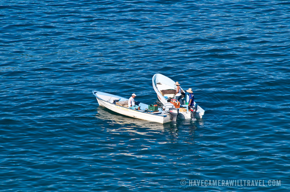 Small fishing boats in the bay at Zihuatanejo, Mexico