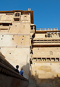 Local man sitting in Jaisalmer Fort, the 'Golden Fort'. It is one of the largest forts in the world. Jaisalmer, Rajasthan, India