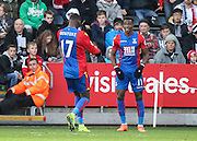 Wilfried Zaha of Crystal Palace celebrates his teams first goal with Christian Beneteke, 0-1, during the Premier League match between Swansea City and Crystal Palace at the Liberty Stadium, Swansea, Wales on 26 November 2016. Photo by Andrew Lewis.