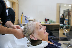 © Licensed to London News Pictures. 04/07/2020. London, UK. SHEILA, a client at Cheriee hair salon on Green Lanes in Harringay, gets her hair washed as the salon reopens on Super Saturday. Cafes, restaurants, pubs and hairdressers across the UK closed on 23 March following the coronavirus lockdown. As restrictions are eased, cafes, restaurants, pubs and hairdressers reopens today. Photo credit: Dinendra Haria/LNP