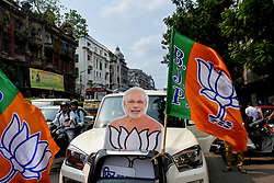 May 23, 2019 - Kolkata, West Bengal, India - BJP supporters decked their car in plackards of Narendra Modi and BJP flag to commemorate the victory in the elections.Celebration started in various parts of Bengal and all over India as BJP touches the magic number of potential victory on over 300 Lok Sabha seats around the country. The election counting is still ongoing and a record victory is expected from currently rulling BJP party and in chair PM Narendra Modi. Results of Bengal are not so different as BJP is expecting to win over 18 seats in the state as the counting heads towards its final phase. (Credit Image: © Debarchan Chatterjee/ZUMA Wire)