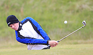 Stuart Grehan (Tullamore) playing from a bunker on the 15th during Round 3 of the East of Ireland Amateur Open Championship at Co. Louth Golf Club, Baltray on Monday 1st June 2015.<br /> Picture:  Thos Caffrey / www.golffile.ie