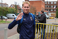 AFC Wimbledon midfielder Mitchell (Mitch) Pinnock (11) arriving and waving during the The FA Cup match between AFC Wimbledon and Doncaster Rovers at the Cherry Red Records Stadium, Kingston, England on 9 November 2019.