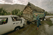 """Stuck yet again and this time rescued by the """"King of the Road"""" (R). En route to the Wakhan Corridor, near Ishkashim.<br /> <br /> Adventure through the Afghan Pamir mountains, among the Afghan Kyrgyz and into Pakistan's Karakoram mountains. July/August 2005. Afghanistan / Pakistan."""