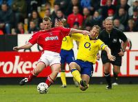Photo. Chris Ratcliffe<br />Charlton v Arsenal. FA Premiership. 26/10/2003<br />Ray Parlour tackles Graham Stuart n the 1-1 draw at the Valley
