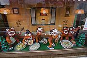 Kokusai-do?ri amusement and shopping street. Shi?sa? figures having fun with plastic food in a restaurant window.