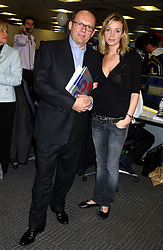 MICHAEL SPENCER and actress ELIZE DU TOIT at the annual ICAP charity day - where all the trading profit made by City firm ICAP are donated to charity, held at their offices at 2 Broadgate, City of London on 7th December 2005.<br /><br />NON EXCLUSIVE - WORLD RIGHTS