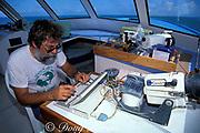 Dr. Pat Colin programs remote video camera to tape <br /> Goliath grouper or jewfish courtship behavior at set intervals, Epinephelus itajara, <br /> Florida ( Gulf of Mexico )