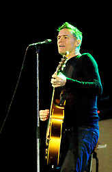 """Bryan Adams plays Doncasters Keepmoat Stadium in South Yorkshire, Bryan played on despite heavy rain proclaiming to the rain soaked crowd """"I can`t believe you have all held out this long""""..20 July 2007.Image COPYRIGHT Paul David Drabble"""