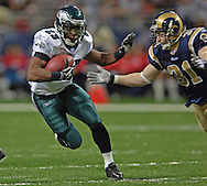 Philadelphia Eagles running back Ryan Moats (L) rushes upfield against pressure from St. Louis Rams strong safety Adam Archuleta (R), during the Eagles 17-16 win at the Edward Jones Dome in St. Louis, Missouri, December 18, 2005.