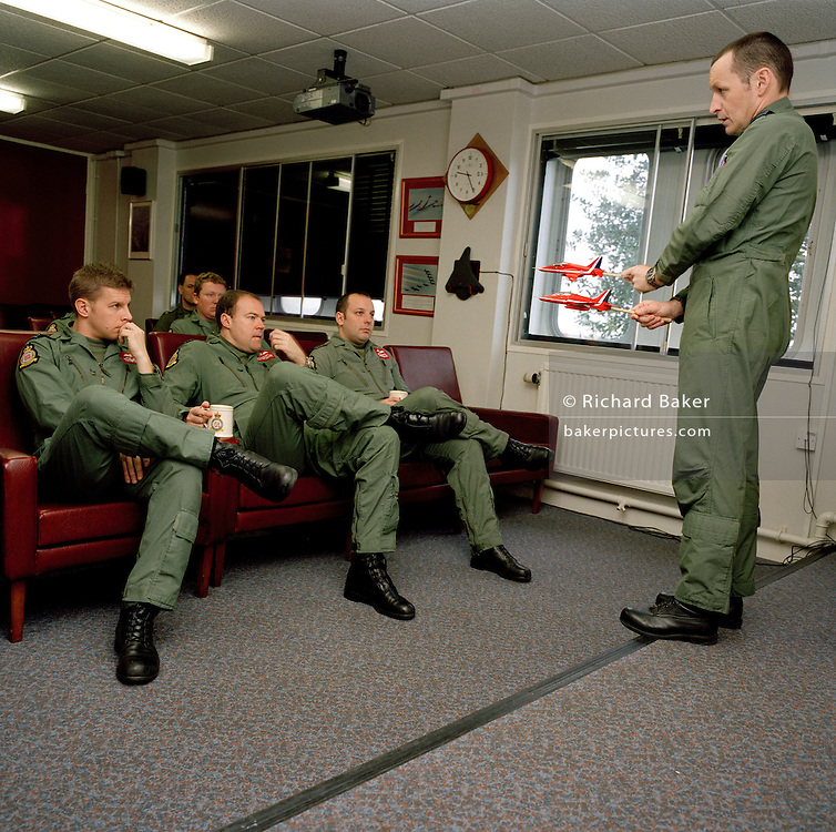 Squadron Leader Spike Jepson, leader of the Red Arrows, Britain's RAF aerobatic team instructs new manoeuvres to his team.