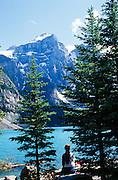 Alberta, Banff National Park. Lake Louise and visitor.