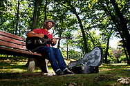 Kevin Bartram   Staff<br /> Isaac Kline spends Thursday afternoon playing his guitar in the shade at Walnut Hill Park in New Britain. Kline plays original songs and is a self-taught guitar player. He performs at local open mic nights.