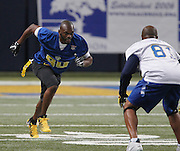 Isaac Bruce (leftr) takes off as he's guarded by Torry Holt in the first quarter.