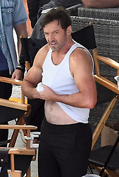 ** PREMIUM EXCLUSIVE RATES APPLY ** Actor Hugh Jackman is seen kissing Swedish actress Rebecca Ferguson on a bed during filming in Miami. The mood on the set seemed light as the actors were seen laughing between takes and even embracing after the final scene was wrapped. 05 Jan 2020 Pictured: Hugh Jackman; Rebecca Ferguson. Photo credit: MEGA TheMegaAgency.com +1 888 505 6342