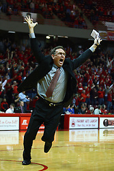 07 January 2012:  Rob Judson circles the north half of the court in a celebration lap after Jackie Carmichael his a 3 point shot to win the game at the buzzer during an NCAA Missouri Valley Conference mens basketball game Where the Purple Aces of Evansville lost to the Illinois State Redbirds 75-73 in Redbird Arena, Normal IL