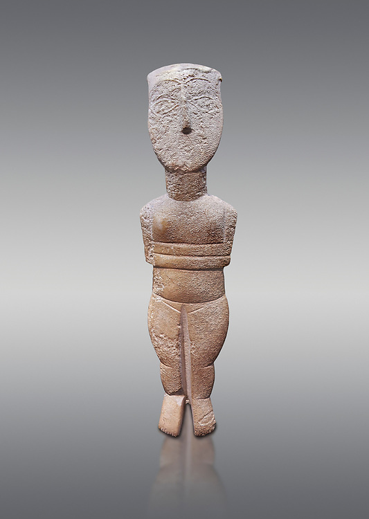 Female figurine statuette : Cycladic Canonical type, Spedos variety. Early Cycladic Period II, (2800-2300 BC), ' Museum of Cycladic Art Athens. Grey Background. <br /> <br /> The cycaldic figurine has its facial features preserved in relief. The eyes, eye brows and hair was probably painted which subsequently protected theses areas of the marble from erosion. Red pigment was found on the cheek and thighs. This is a mature work of the Spedos variety