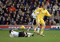 Photo: Kevin Poolman.<br />Derby County v Sheffield Wednesday. Coca Cola Championship. 13/01/2007. Chris Brunt of Wednesday is tackled by Derby's Marc Edworthy.