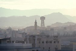 Taif skyline located in the Southwestern region of Saudi Arabia in the Asir mountains featuring a water tower and a minaret.