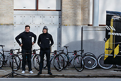 Ronny Lauke and Sebastian Nittke keep guard over the CANYON//SRAM Racing bikes in Ieper - Women's Gent Wevelgem 2016, a 115km UCI Women's WorldTour road race from Ieper to Wevelgem, on March 27th, 2016 in Flanders, Belgium.