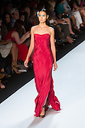 Red strapless gown with slit side. By Monique Lhuillier at Spring 2013 Fall Fashion Week in New York.