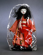 Japanese doll with plastic cover