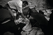 """Athens, Greece - Amalia Valdovu, a 22 years old girl from Romania, lies dead on the sidewalk. She was homeless and a drug addict. When she started to feel sick somebody called the ambulance. It took it 50 minutes to arrive: it was too late. Greek economical crisis started in 2008. The so-called Austerity measures imposed to the country by the """"Troika"""" (European Union, European Central Bank, and International Monetary Fund) to reduce its debt, were followed by a deep recession and the worsening of life conditions for millions of people. Unemployment rate grew from 8.5% in 2008 to 25% in 2012 (source: Hellenic Statistical Authority).<br /> Bruno Simões Castanheira"""