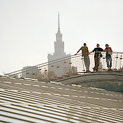 Students on the roof of Warsaw University with a view to the Palace of Arts and Culture, Warsaw, Poland