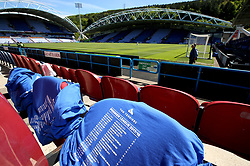 Huddersfield Town shirts are placed on seats for fans before the match begins
