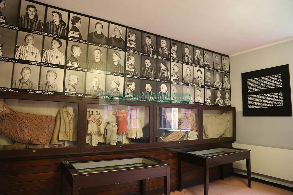 Pictures and belongings of young victims are on display at Auschwitz-Birkenau Memorial and Museum in Auschwitz, Poland on September 3, 2017. Auschwitz concentration camp was a network of German Nazi concentration camps and extermination camps built and operated by the Third Reich in Polish areas annexed by Nazi Germany during WWII. It consisted of Auschwitz I (the original camp), Auschwitz II–Birkenau (a combination concentration/extermination camp), Auschwitz II–Monowitz (a labor camp to staff an IG Farben factory), and 45 satellite camps. In September 1941, Auschwitz II–Birkenau went on to become a major site of the Nazi Final Solution to the Jewish Question. From early 1942 until late 1944, transport trains delivered Jews to the camp's gas chambers from all over German-occupied Europe, where they were killed en masse with the pesticide Zyklon B. An estimated 1.3 million people were sent to the camp, of whom at least 1.1million died. Around 90 percent of those killed were Jewish; approximately 1 in 6 Jews killed in the Holocaust died at the camp. Others deported to Auschwitz included 150,000 Poles, 23,000 Romani and Sinti, 15,000 Soviet prisoners of war, 400 Jehovah's Witnesses, and tens of thousands of others of diverse nationalities, including an unknown number of homosexuals. Many of those not killed in the gas chambers died of starvation, forced labor, infectious diseases, individual executions, and medical experiments. In 1947, Poland founded a museum on the site of Auschwitz I and II, and in 1979, it was named a UNESCO World Heritage Site. Photo by Somer/ABACAPRESS.COM