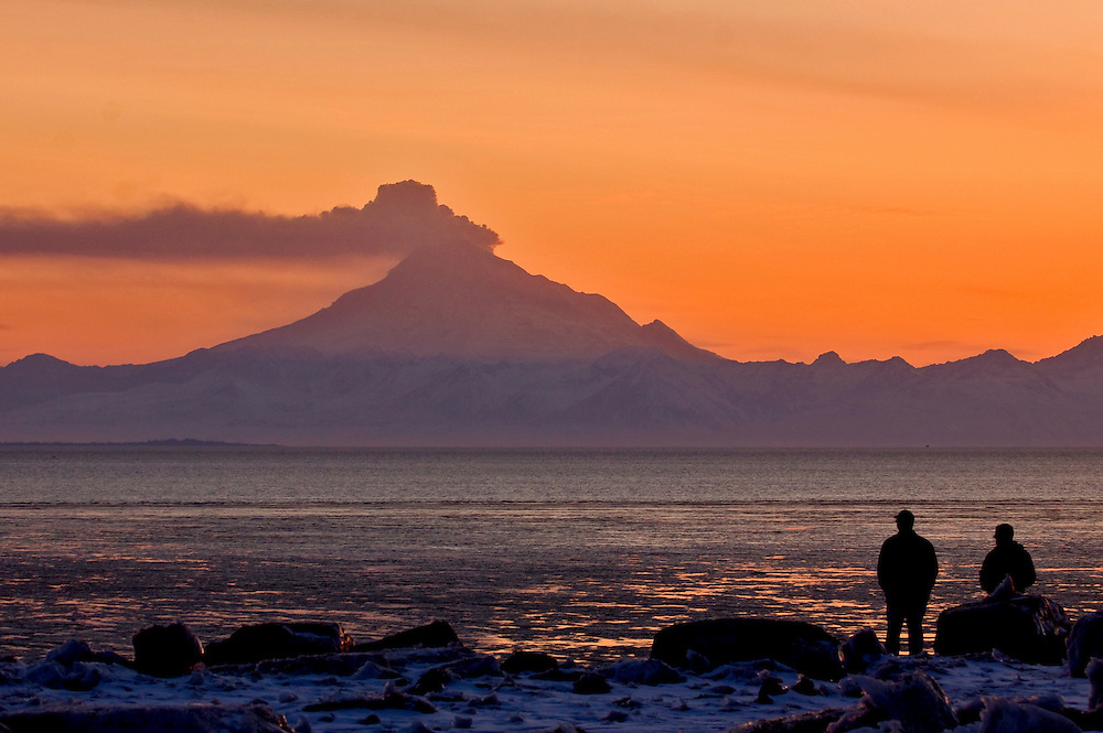 Alaska. Mt Redoubt volcano emitting steam with some ash, as viewed from Kenai visitors.