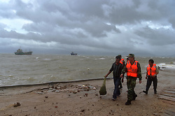 FUJIAN, Sept. 14, 2016 (Xinhua) -- Border guards evacuate fishermen from the coast in Fuqing, southeast China's Fujian Province, Sept. 14, 2016. China's National Marine Environmental Forecasting Center (NMEFC) on Wednesday upgraded its warning for ocean waves triggered by Typhoon Meranti to ''red,'' the highest of a four-color warning system. (Xinhua/Wei Peiquan) (zyd) (Credit Image: © Wei Peiquan/Xinhua via ZUMA Wire)