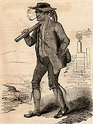 A typical English pitman (coal miner) carrying his pickaxes, smoking a clay pipe. From 'The Illustrated London News' 1884.