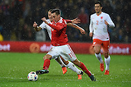 Tom Lawrence of Wales (11) makes a break. Vauxhall International football friendly, Wales v The Netherlands at the Cardiff city stadium in Cardiff, South Wales on Friday 13th November 2015. pic by Andrew Orchard, Andrew Orchard sports photography.