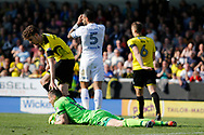Leeds United defender Kyle Bartley (5) reacts as Leeds United striker Kemar Roofe (7) shot is saved by Burton Albion goalkeeper Stephen Bywater (13) during the EFL Sky Bet Championship match between Burton Albion and Leeds United at the Pirelli Stadium, Burton upon Trent, England on 22 April 2017. Photo by Richard Holmes.