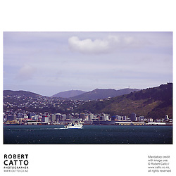 The Interisland Ferry approaches Wellington Harbour seen from Somes Island, Wellington, New Zealand.<br />