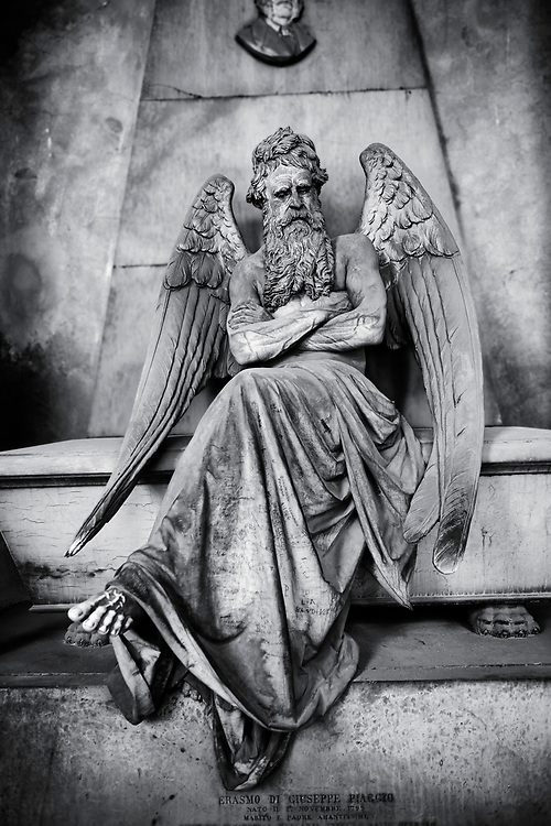 Heavens Gate - Black and white art photo of the stone sculpture of an angel sitting on a sarcophagus. Piaggio Tomb sculpted by S Saccomanno 1876. Section A, no 46, The  monumental tombs of the Staglieno Monumental Cemetery, Genoa, Italy .<br /> <br /> Visit our PEOPLE & PLACES PHOTO ART COLLECTIONS for more photos to buy as buy as wall art prints https://www.photoshelter.com/mem/images/index#/C00001WetsxVxNTo/