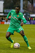 Watford midfielder Ken Sema (12) on the ball during the The FA Cup 3rd round match between Woking and Watford at the Kingfield Stadium, Woking, United Kingdom on 6 January 2019.
