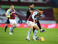 Football - 2020 / 2021 Premier League - Aston Villa vs West Ham United - Villa Park<br /> <br /> West Ham United's Jesse Lingard battles for possession with Aston Villa's Douglas Luiz.<br /> <br /> COLORSPORT/ASHLEY WESTERN
