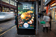 Bus shelter advert for Tesco Christmas turkey on 27th November 2019 in London, England, United Kingdom. Christmas dinner is a traditional meal usually eaten on Christmas Day. Usually with turkey meat as it's centre, it is often particularly rich and substantial, in the tradition of the Christian feast day celebration, and forms a significant part of gatherings held to celebrate the arrival of Christmastide.
