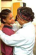 African American mom and daughter age 42 and 13 talking.  St Paul Minnesota USA