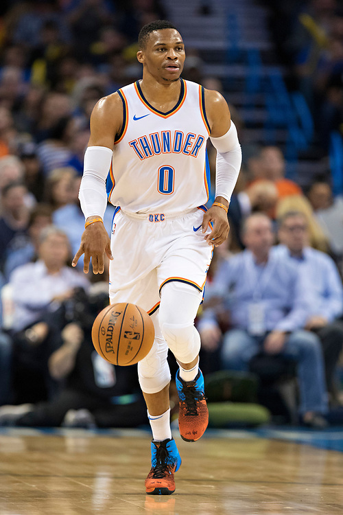 OKLAHOMA CITY, OK - OCTOBER 25:  Russell Westbrook #0 of the Oklahoma City Thunder brings the ball down the court during a game against the Indiana Pacers at the Chesapeake Energy Arena on October 25, 2017 in Oklahoma City, Oklahoma.  NOTE TO USER: User expressly acknowledges and agrees that, by downloading and or using this photograph, User is consenting to the terms and conditions of the Getty Images License Agreement.  The Thunder defeated the Pacers 114-96.  (Photo by Wesley Hitt/Getty Images) *** Local Caption *** Russell Westbrook