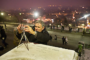 DIGITAL PHOTOGRAPHY. Snow, Arctic temperatures and big freeze in Paris, France. Tourists set up photographs of themselves nearby Sacre-Coeur during a night of heavy snow. Temperatures plummeted below zero, as low as -9. Very rarely, certainly not for decades, that Paris has experienced such freezing cold weather. Snow normally disappears in a couple of hours, this time it stuck around for days. Freak weather conditions and climate change can often be attributed to global warming and the ozone layer.