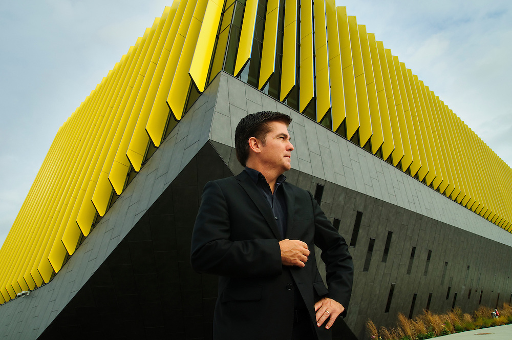 JGMA Principal Architect Juan Moreno, AIA, is designer of the new Northeastern Illinois University (NEIU) El Centro Campus. The irregularly-shaped building is covered in bi-colored sunscreen fins that allow light in while offering kinetic visuals to traffic on the adjacent Kennedy Expressway. Thursday, October 20th. @ NEIU El Centro. ©2014 Brian J. Morowczynski- ViaPhotos.com