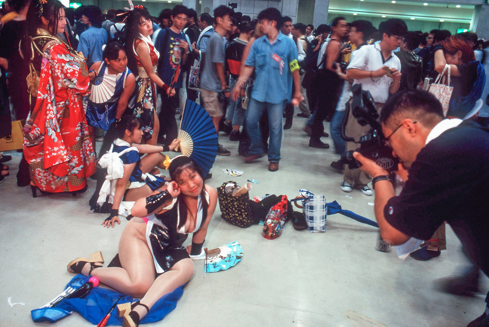 """TOKYO, JAPAN --- August 1999:  Costume players at the """"Comiket"""" comic market. --- Photo by Tom Wagner/Corbis SABA"""