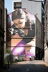 Large mural painted on building in central Glasgow, Scotland, United Kingdom