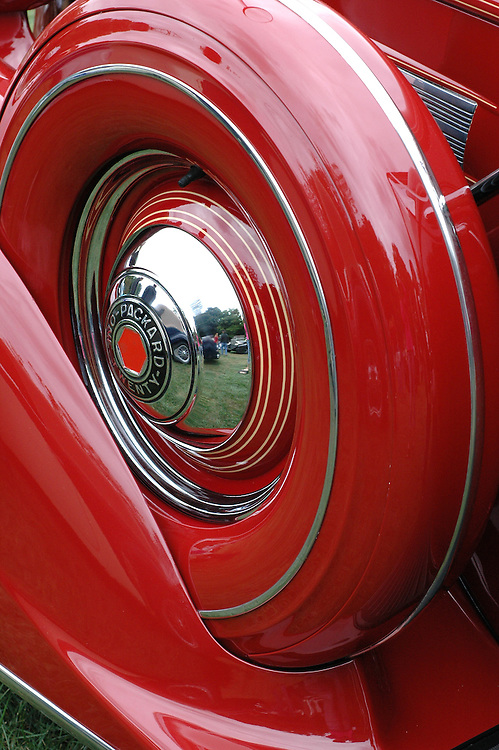Red abstract of antique packard wheel