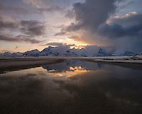 Mountain reflection on Ytresand beach at sunrise, Moskenesøy, Lofoten Islands, Norway