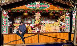Edinburgh's Christmas 2019: a stallholder in Princes Street Gardens waiting for customers