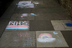 © Licensed to London News Pictures. 13/04/2020. London, UK. Drawings by children on a pavement in north London in support of the NHS. Coronavirus lockdown continues to slow the spread of COVID-19 and reduce pressure on the NHS. Photo credit: Dinendra Haria/LNP